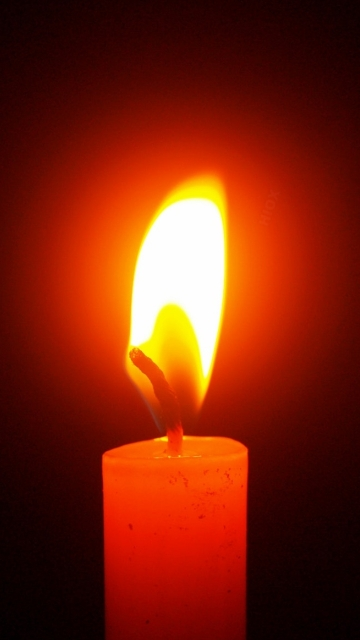 Candle Light Over Dark Background Hd Image