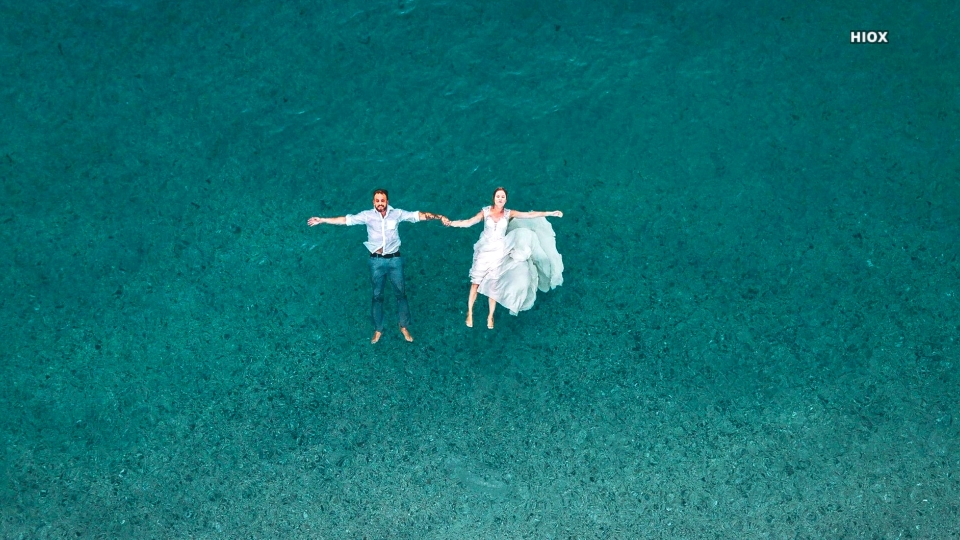 Hd Image Of Man And Woman Floating On Beach Water