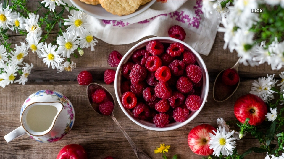 Table Of Flowers And Red Berries Hd Wallpaper Photo