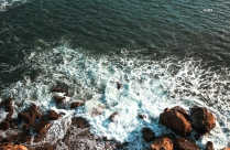 Brown Rocky Shore With Waves Hd Picture