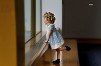 Hd Image Of A Baby Girl Looking Through Window