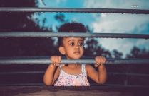 Hd Image Of Little Girl Standing Beside Fence