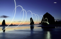 HD Light Painting Spirals Over The Water