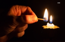 Person Lighting Candle Focus Photography Hd Image