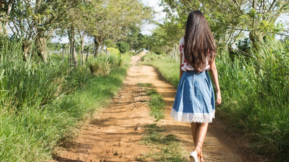 Woman Walking On Mud Road Hd Picture